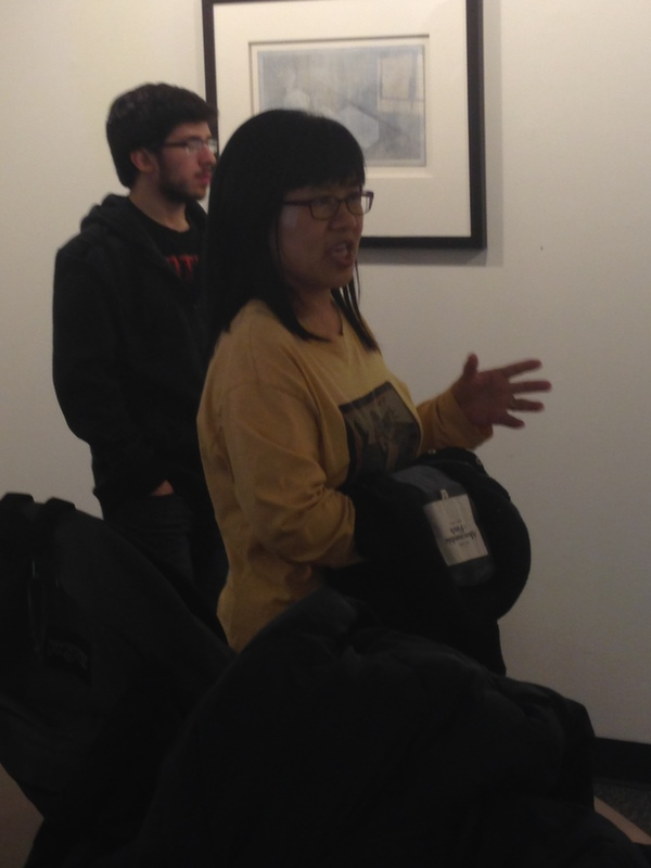 Fides Learning Community student Chiang Chiang Chen-Ho asks a question during artist Andrew Hairstans' gallery talk.