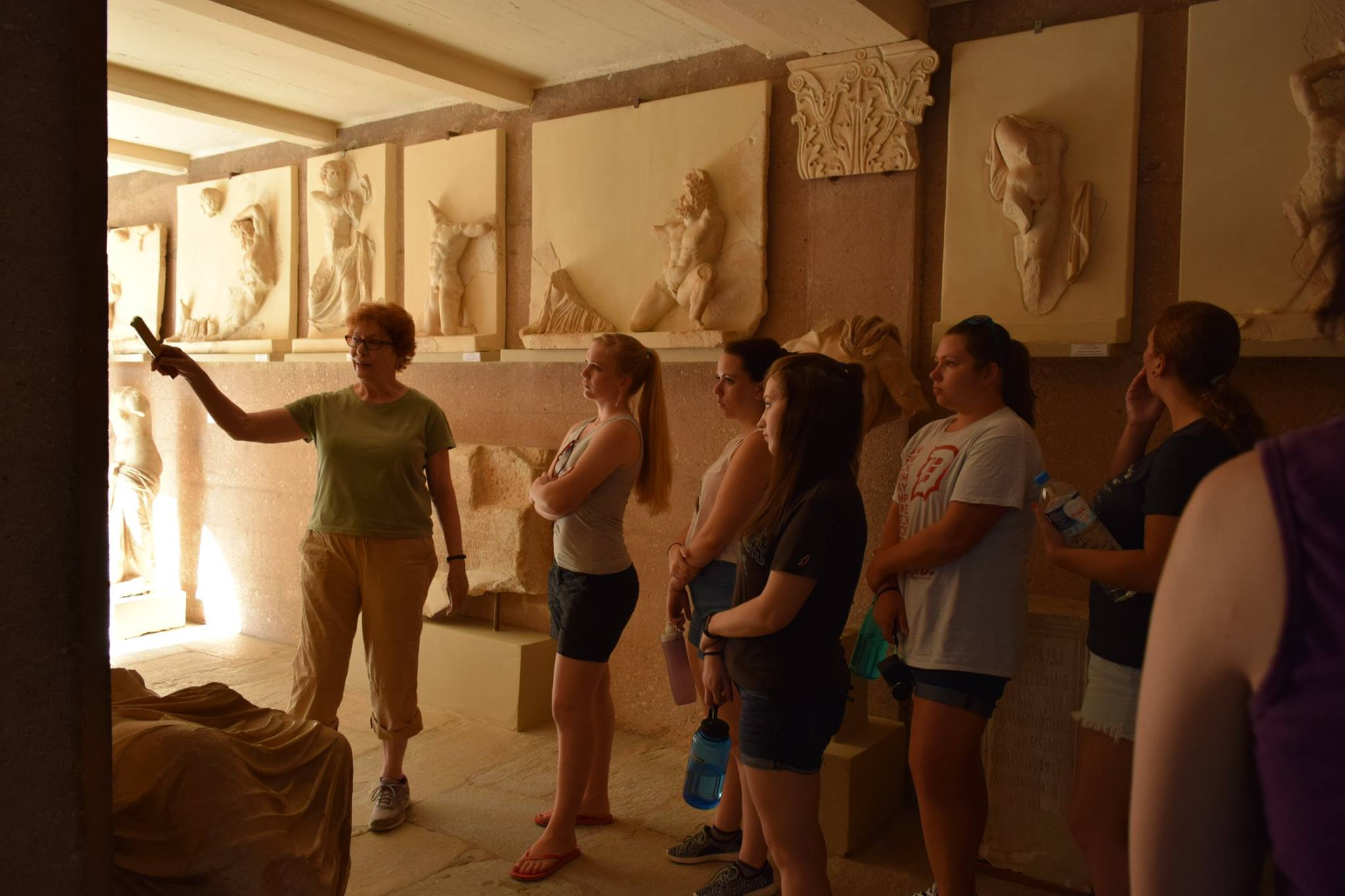 Classical scholar Mary Sturgeon gives a tour of Corinth's sculpture to our students.