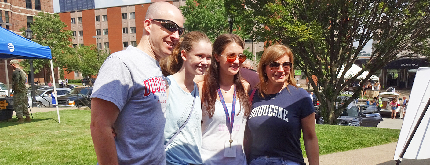 Family posing for photo during Move-In