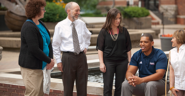 Members of the Duquesne community by the fountain.