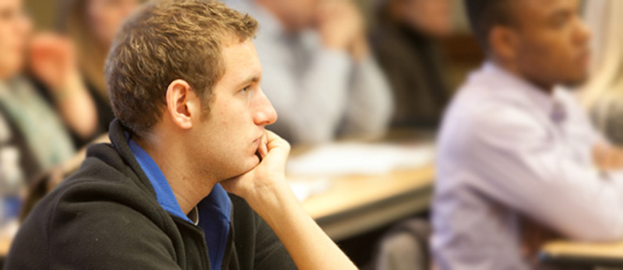 Photo of male law school student in class