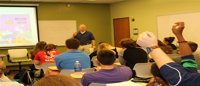 Dr. Mark Haas engages his class in discussion.