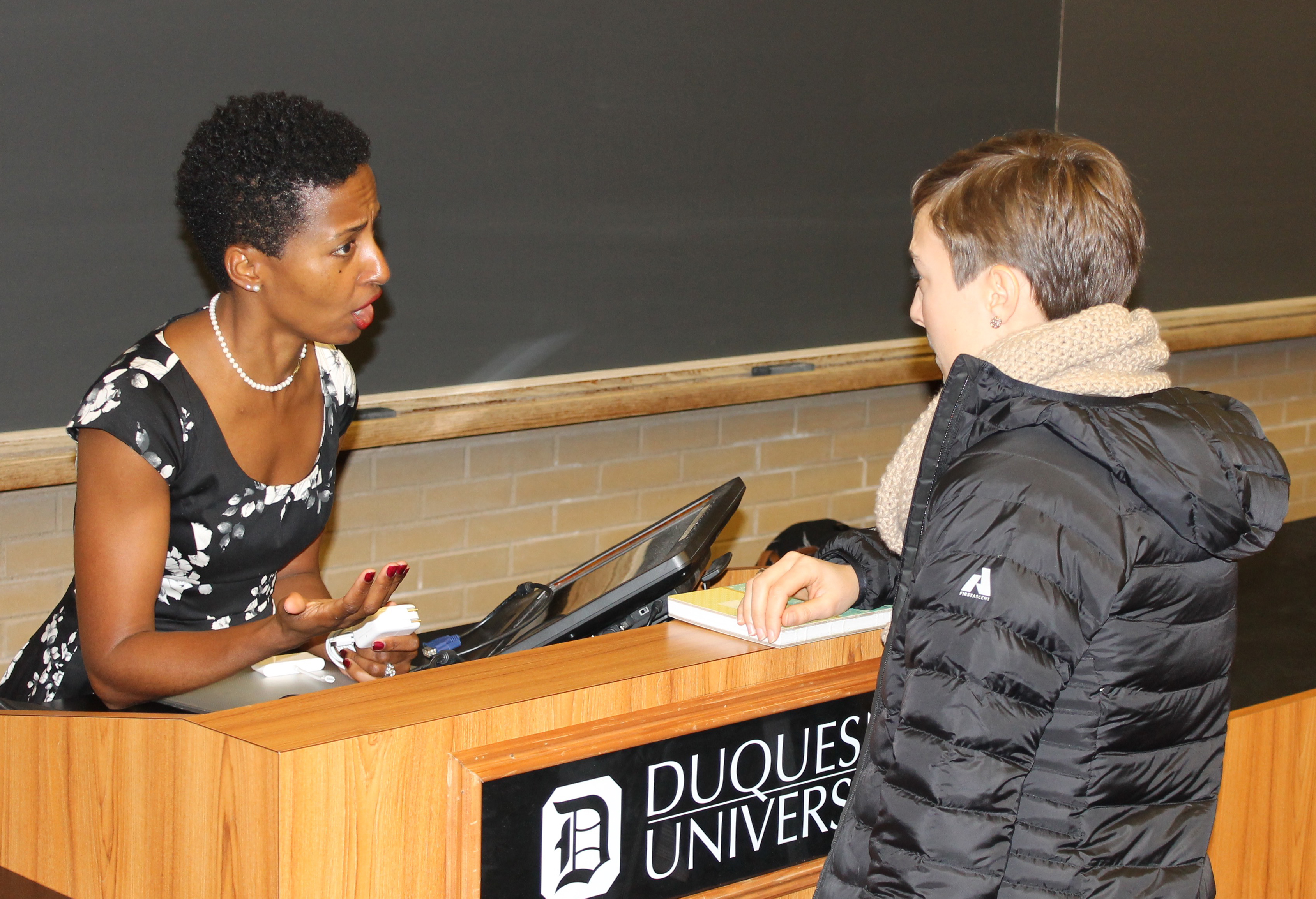 Speaker Ayana Ledford (left) led an interactive workshop on the importance of negotiations.