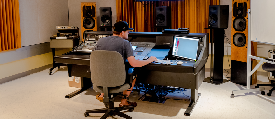 A student works at the console in the Schrecengost Mastering Suite.