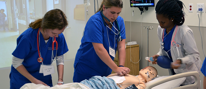 Photo of three students in the simulation lab