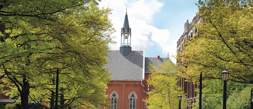 view of Admin building and Chapel bell from Academic Walk