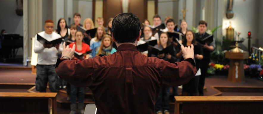 conductor leading church choir