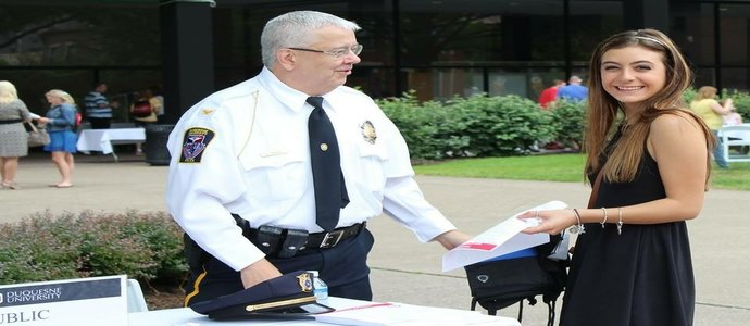 Deputy Chief with student during Orientation