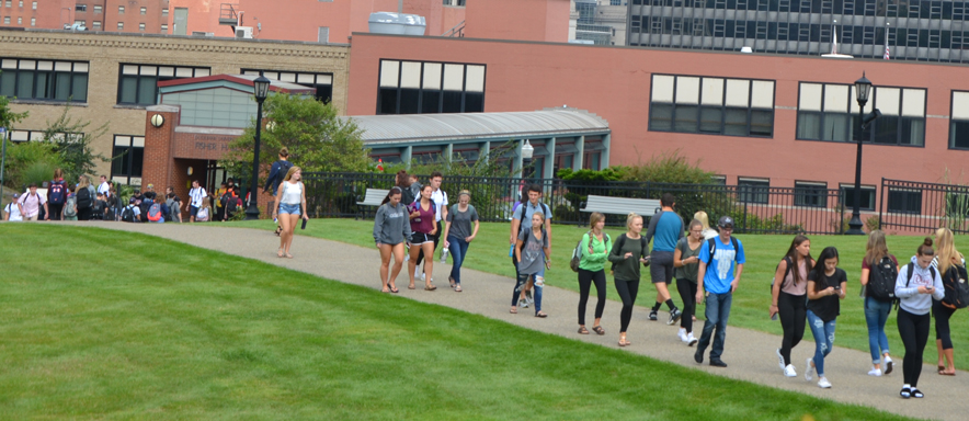 Students walking along Brottier Commons