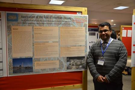 Student Aiyub Alwehaibi poses by his poster entitled,