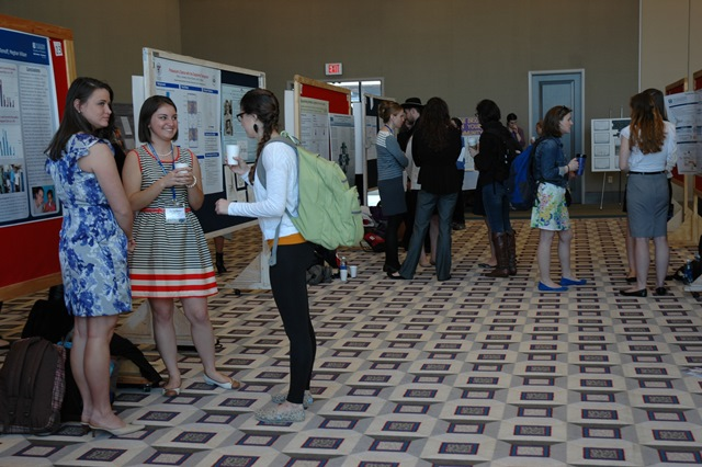 Students mingle to discuss research