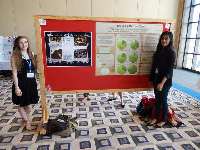 Sophie Noonan and Shacini Mustachi pose next to their posters.