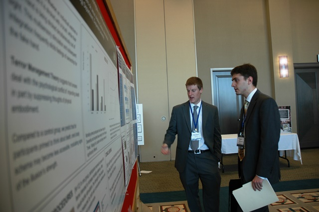 Students Christopher Ignatz and Franklin J. Giovannelli discuss a poster.