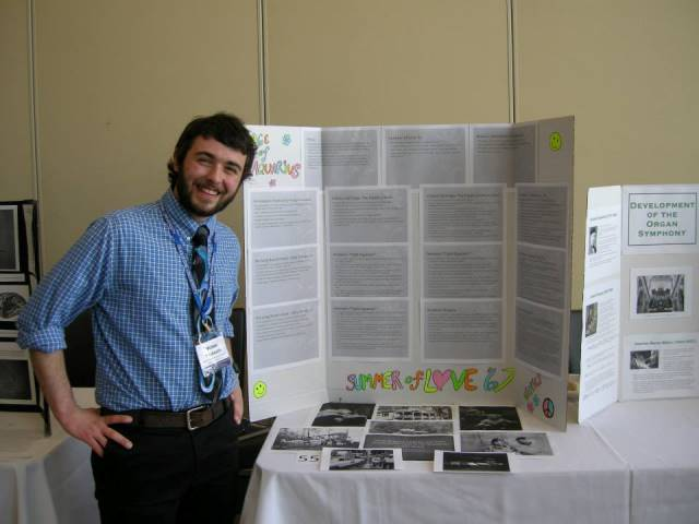 Michael Praskovich poses next to his poster.