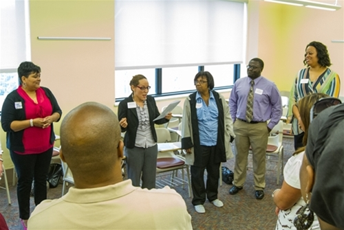 Dr. Sandra Quinones engage workshop learners.