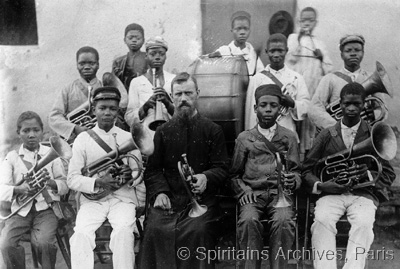 Caconda, Angola, early 1900s. Fr. Aimé Viezier with his band.