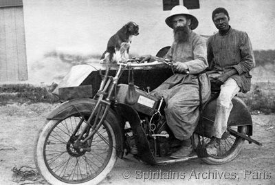 Cubango, Angola, 1920. Fr. Laagel, his catechist and their dog on motorbike.