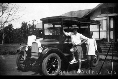Emekuku, Nigeria, 1928. Fr. Philip O'Connor with his car.