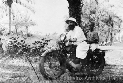Cameroon, 1930s. Fr. André with his young assistant on motorbike.
