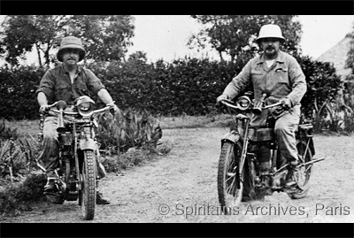 Ogoja, Nigeria, 1930. Frs. Biechy and Soul visit their parishioners on motorbike.