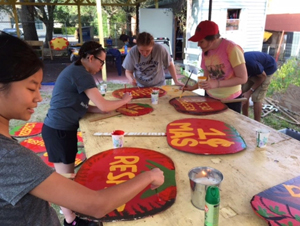 students painting signs in Imokalee