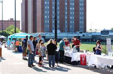 Families and staff on Academic Walk at Open House event