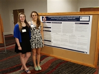 Athletic Training Students standing with poster at 2016 PATS Meeting