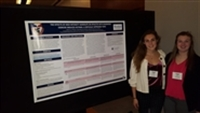 Athletic Training Students standing with poster at EATA Meeting