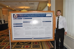 Athletic Training Student standing with poster at PATS Meeting