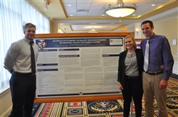 Athletic Training Students standing with poster at PATS Meeting