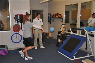 Athletic training student providing rehab assistance