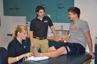 Athletic training student delivering ultrasound to patient