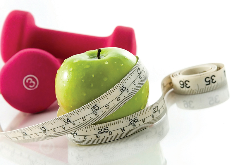 Apple, weights and measuring tape