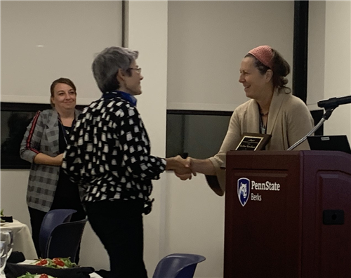Inci Ozum Ucok-Sayrak, Ph.D. (left) accepting award from Janie Harden Fritz, Ph.D. (right)