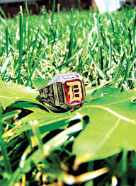 Duquesne University Class Ring in Grass