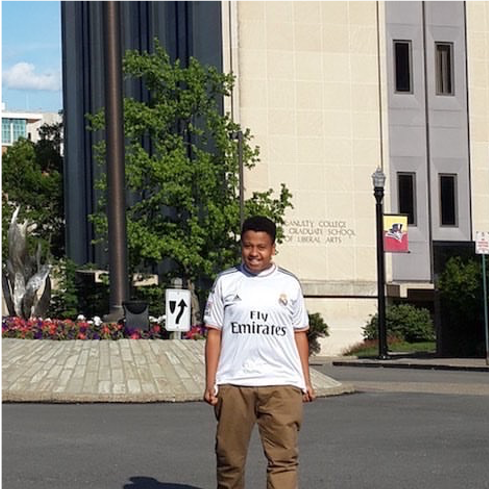 Mohammed in front of College Hall