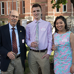 Students and a Duquesne donor attend the 2017 Duquesne Society Cocktails event