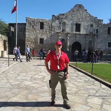 Duquesne alum David Harkleroad stands in front of Alamo Building in San Antonio, Texas