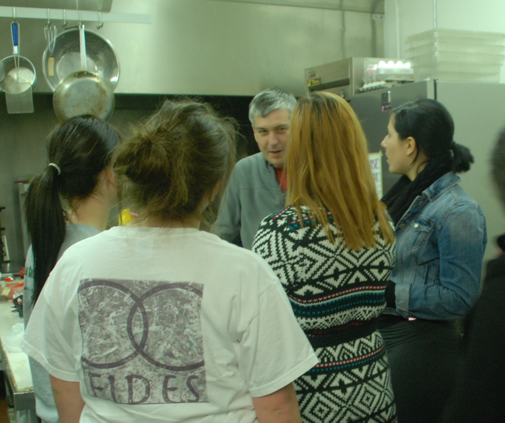 FIDES students serving at The Table soup kitchen