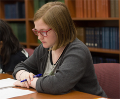 Photograph of a high school student writing