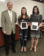 Dr. Kern presents Brianna Camp and Jessica Schreiber with the 2018 Charles Loch Excellence in Mathematics Award