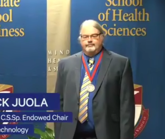 Dr. Juola receiving Endowed appointment
