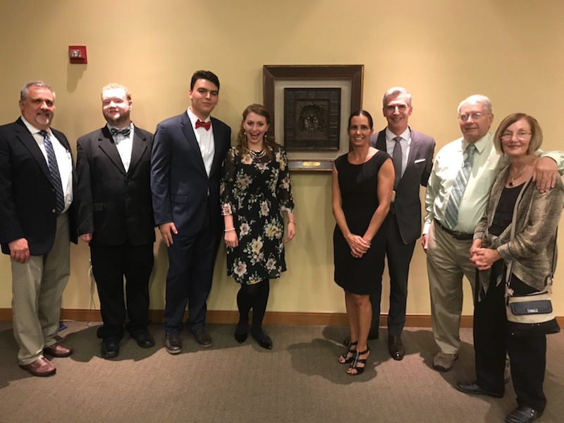 Winners of the voice competition with judge Ray Very, along with members of the family of Marguerite DePhillips Dougherty.