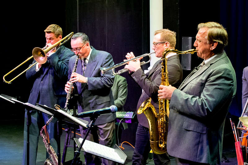 Mike Tomaro and several others play at an Uptown Jazz Series concert.