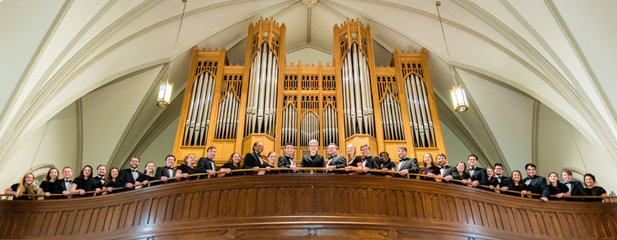 Voices of Spirit on a balcony in front of an organ
