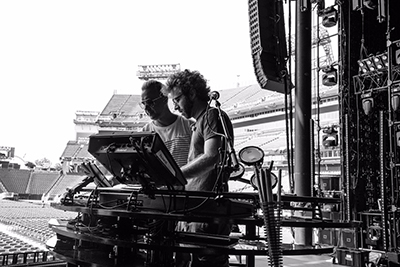 Nathan Barlowe (left), and Nate Dickinson, work on programming during soundcheck for CMA festival, Nashville, Tennessee