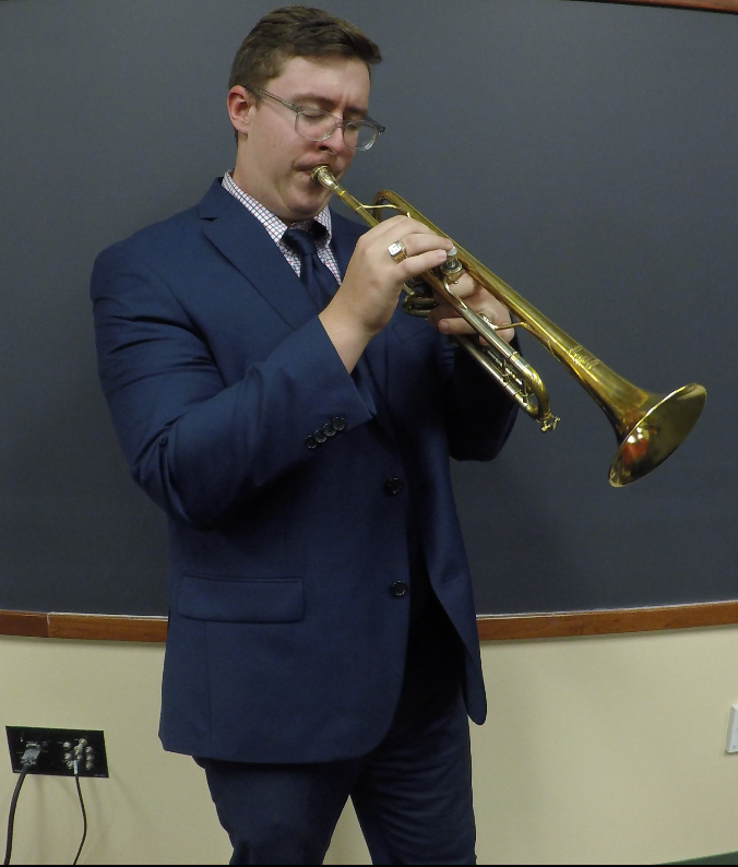 Alvin Siimpson playing trumpet