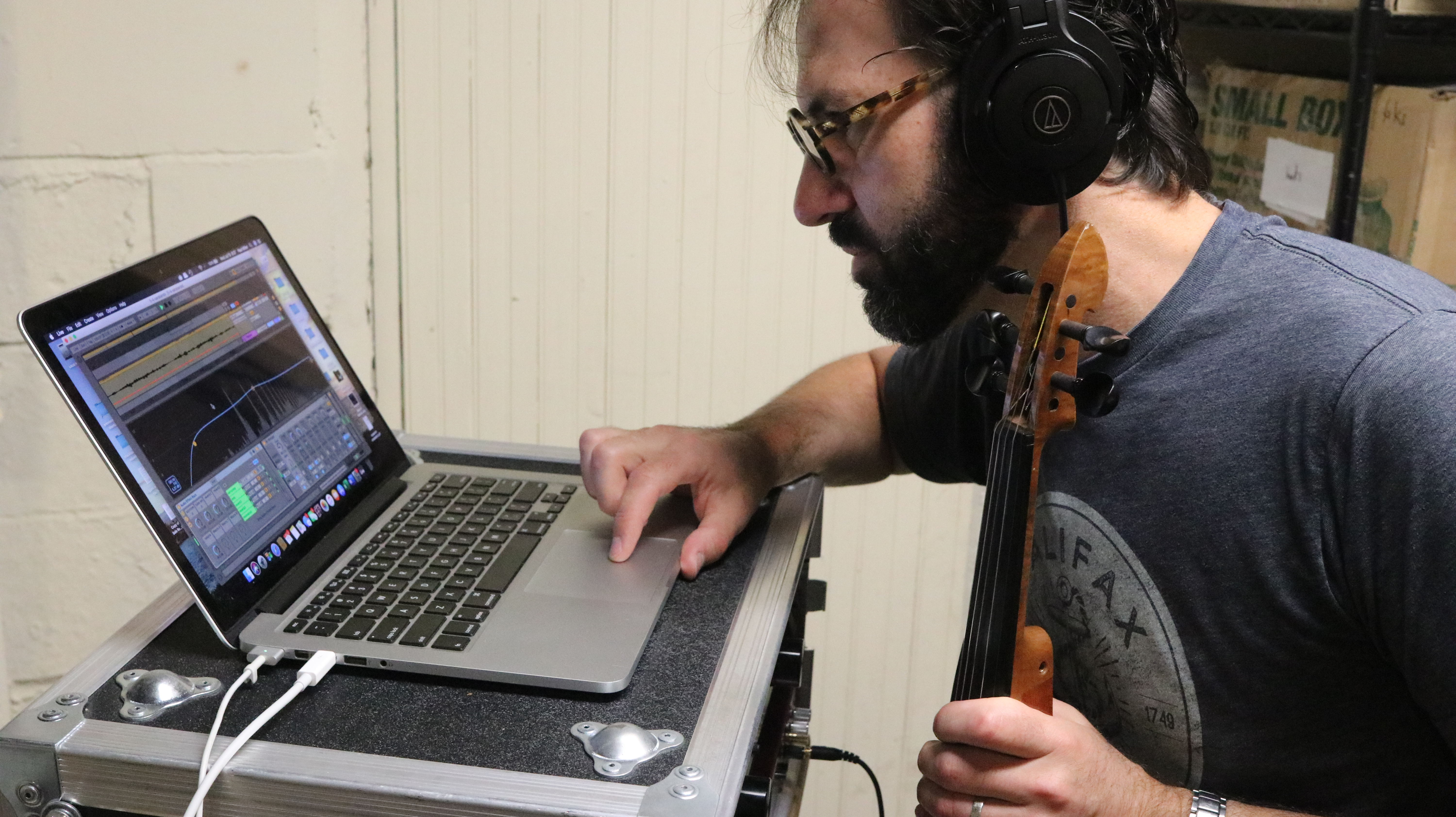 Paul Miller working on a recording on his laptop.