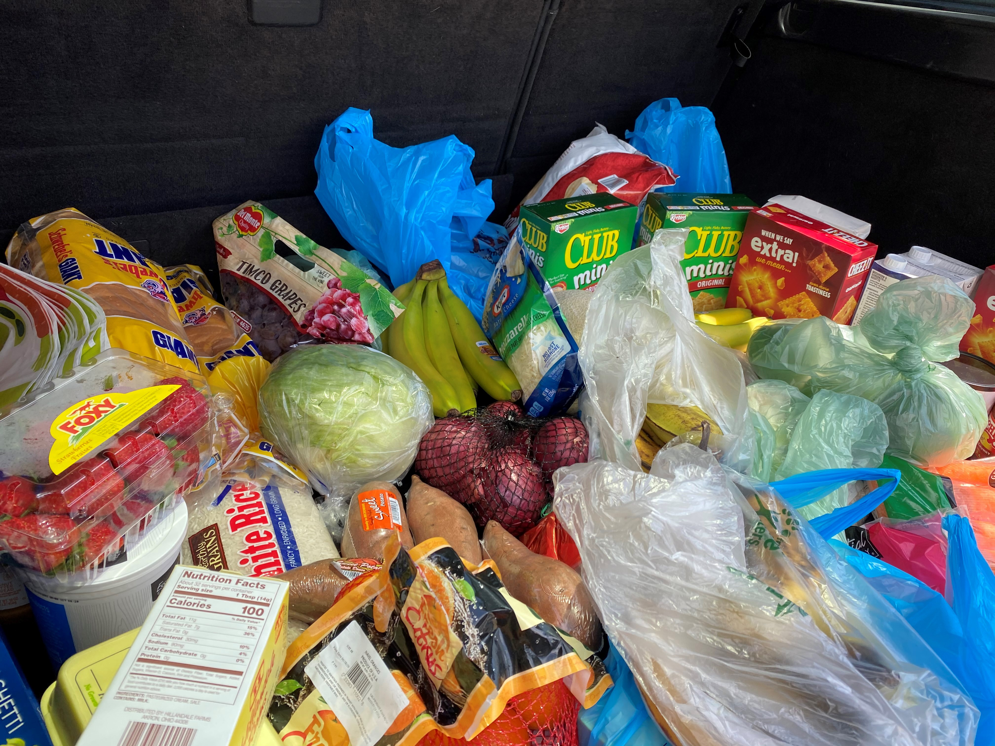 groceries in the trunk of an SUV