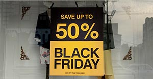 store window with black friday sale sign